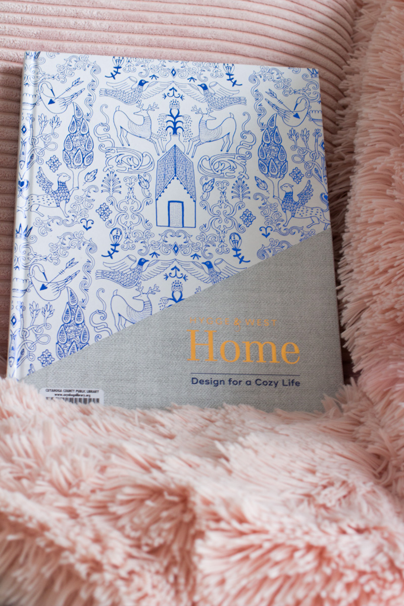 "The cover of ""Hygge & West: Design for a Cozy Life"" by Christiana Coop and Aimee Lagos"